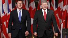 British Prime Minister, left, and Canadian Prime Minister Stephen Harper take part in a joint news conference on Parliament Hill in Ottawa, Sept. 22, 2011. (BLAIR GABLE)