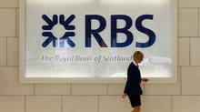 A worker walks in the foyer of a Royal Bank of Scotland (RBS) office in the City of London in this August 6, 2010 file photo. (LUKE MACGREGOR/REUTERS)