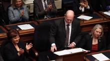 B.C. Finance Minister Mike de Jong, tables the budget in the Legislative Assembly in Victoria, B.C., Tuesday February 17, 2015 as Premier Christy Clark applauds. (CHAD HIPOLITO/THE CANADIAN PRESS)