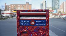 A Canada Post mail box is located on the corner of Wellington St. Wet and Spadina Ave. Canada Post announced they will be replacing thousands of locks on community mailboxes in response to complaints of locks freezing last winter. (Fred Lum/The Globe and Mail)