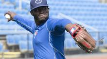 Toronto Blue Jays outfielder Anthony Alford throws at spring training in Dunedin, Fla., on Feb. 24. (Frank Gunn/THE CANADIAN PRESS)