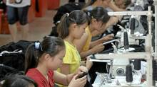 Fashion exacts a toll on those who produce it. (JIANAN YU/Reuters)