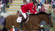 Canada's Ian Millar, from Perth, Ont., rides his horse Star Power over a jump in the Equestrian Individual Jumping final 2012 Summer Olympics Wednesday in London. Miller finished in ninth place. (Ryan Remiorz/Canadian Press)