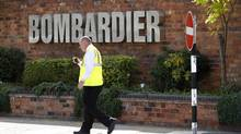 A worker walks past the entrance to the Bombardier plant in Derby, central England, July 5, 2011. (DARREN STAPLES/DARREN STAPLES/REUTERS)