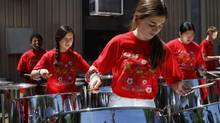 Marcus Reeeb (L), Ellen Harper, Elodie Oliver, Victoria Crichton and Will Adams, members of The Toronto All Stars Steel Orchestra, practise at Rosedale Public School, Toronto June 30 2011. (Fernando Morales/The Globe and Mail)