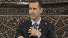 Syrian President Bashar Al-Assad addresses the parliament in Damascus in this still image taken from a video footage March 30, 2011. Al-Assad said on Wednesday that Syria is the target of a 'conspiracy' to sow sectarian strife, but some Syrians who have demonstrated against his rule had legitimate demands. (REUTERS TV/Syrian state TV via Reuters TV)