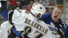 File photo: Donald Brashear #87 of the Washington Capitals fights Wade Belak #3 of the Toronto Maple Leafs during their NHL game at the Air Canada Centre December 23, 2006 in Toronto, Ontario. (Photo by Dave Sandford/Getty Images) (Dave Sandford/2006 Getty Images)