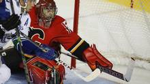 Goalie Jonas Hiller signed a two-year, $9-million (U.S.) deal with the Flames after leaving the Anaheim Ducks. (Jeff McIntosh/THE CANADIAN PRESS)