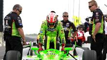 Andretti Autosport driver James Hinchcliffe climbs into his race car during a practice session at the Indianapolis Motor Speedway in Indianapolis, Indiana May 16, 2013. The 97th running of the Indianapolis 500 is scheduled for May 26. (BRENT SMITH/REUTERS)