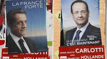 Posters of France's Socialist Party candidate François Hollande, and current French President Nicolas Sarkozy, are posted in front of a school in Marseille. The second round of the presidential elections will take place on May 6. (Claude Paris/Associated Press)