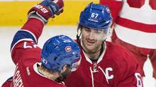 Montreal Canadiens' Max Pacioretty celebrates with teammate Alex Galchenyuk, left, after scoring against the Detroit Red Wings during third period NHL hockey action in Montreal on Tuesday, March 29, 2016. (Graham Hughes/THE CANADIAN PRESS)