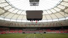 Vancouver Whitecaps' players stretch during a Major League Soccer training session at B.C. Place in Vancouver, B.C. The venue will be one of six Canadian facilities used to host the 2015 FIFA Women's World Cup. (File photo) (DARRYL DYCK/THE CANADIAN PRESS)