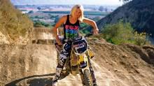 Jolene Van Vugt atop her MX vs. ATV Reflex-branded dirt bike.
