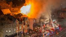 "Ninety firefighters worked to put out the blaze that gutted 116 Avenue Road, home of the restaurant Sotto Sotto. Officials are treating the fire as ""suspicious,"" saying that it could take several months to determine the cause. (Hamilton Greenwood)"