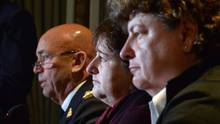 RCMP commissioner Bob Paulson, left, answers a question during a news conference, as plaintiffs Janet Merlo, centre, and Linda Davidson look on in Ottawa on Thursday, Oct. 6, 2016. (Adrian Wyld/THE CANADIAN PRESS)