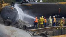 Crews work near derailed tanker cars in Lac-Mégantic, Que., on July 14, 2013. (Peter Power/The Globe and Mail)