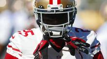 San Francisco 49ers cornerback Tarell Brown hangs his gloves from his helmet during a NFL Super Bowl XLVII football practice in New Orleans January 31, 2013. San Francisco 49ers will play against the Baltimore Ravens on February 3. (JEFF HAYNES/REUTERS)