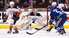 Anaheim Ducks goaltender John Gibson watches as Vancouver Canucks' Luca Sbisa controls the puck during first period NHL action in Vancouver, B.C., on Thursday February 18, 2016. (BEN NELMS/THE CANADIAN PRESS)