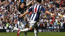 West Bromwich Albion's Zoltan Gera (L) celebrates his goal against Liverpool with Shane Long during their English Premier League soccer match at The Hawthorns in West Bromwich, central England, August 18, 2012. (DARREN STAPLES/REUTERS)