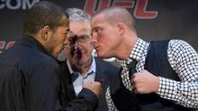 UFC featherweight champion Jose Aldo, left, from Brazil, squares off with opponent Erik Koch, right, as UFC's Canadian Operations Director Tom Wright looks on after a press conference promoting the upcomng July 21 event in Calgary (Larry MacDougal/The Canadian Press)