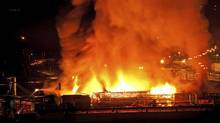 A large fire burns at the Lakeland Mills sawmill in Prince George, B.C., on Tuesday April 24, 2012. An explosion rocked the sawmill just before 10 p.m. local time setting off a fire that engulfed the facility. THE CANADIAN PRESS/Andrew Johnson (ANDREW JOHNSON/Andrew Johnson/The Canadian Press)