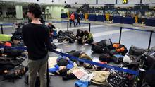 European passengers sleep on the floor of Beijing Capital International airport after flights from China to Europe were cancelled on April 19, 2010 (OLLI GEIBEL)