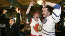 Toronto Maple Leafs fans (L-R) Mo Juma, Todd Nicholl and Ryan Snow react to the New Jersey Devils game tying goal in the final second of regulation play at Gretzky's restaurant in Toronto, April 8, 2007. (J.P. MOCZULSKI for The Globe and Mail)