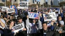 Chicago Cubs fans celebrate before a rally in Grant Park honoring the World Series champions Friday, Nov. 4, 2016, in Chicago. (Charles Rex Arbogast/AP)