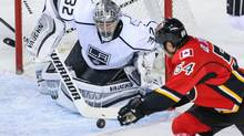 Los Angeles Kings goalie Jonathan Quick makes a save as Calgary Flames right wing David Jones tries to score during the second period at Scotiabank Saddledome. (Sergei Belski/USA Today Sports)