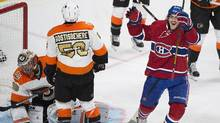 Philadelphia Flyers goaltender Michal Neuvirth and Shayne Gostisbehere react after being scored on by Montreal Canadiens' Phillip Danault, right, during third period NHL hockey action in Montreal, Saturday, November 5, 2016. (Graham Hughes/THE CANADIAN PRESS)
