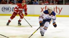 Edmonton Oilers center Connor McDavid (97) goes for the puck as he is trailed by Detroit Red Wings center Darren Helm (43) during the first period of an NHL hockey game in Detroit, Sunday, Nov. 6, 2016. (Jose Juarez/AP)