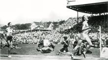 The Miracle Mile in Vancouver at the British Empire Games (now called Commonwealth Games). At the finish it was England's Dr. Roger Bannister by several yards over the world record-holder John Landy. Both runners finished under the once-mythical four minutes. Bannister's time was 3:58.8, Landy's 3:59.6. (AP)