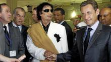 Libya's President Muammar Gaddafi (L) greets his counterpart from France Nicolas Sarkozy at Bab Azizia Palace in Tripoli July 25, 2007, the day after the release of six foreign medics from Libyan jails. (PASCAL ROSSIGNOL/REUTERS/PASCAL ROSSIGNOL/REUTERS)