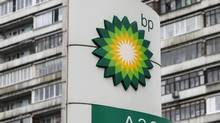 A BP logo is seen in front of an apartment block near a petrol station in Moscow October 22, 2012. (MAXIM SHEMETOV/REUTERS)