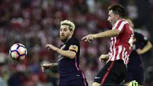 FC Barcelona's Lionel Messi, left, duels for the ball with Athletic Bilbao's Aymeric Laporte, right, during the Spanish La Liga soccer match between FC Barcelona and Athletic Bilbao, Aug. 28, 2016. (Alvaro Barrientos/AP)