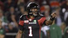 Ottawa Redblacks quarterback Henry Burris (1) makes a call during second half CFL action against the Saskatchewan Roughriders on Friday, Oct. 7, 2016 in Ottawa. It's Burris's time with the Ottawa Redblacks again.The CFL's outstanding player last season will lead Ottawa into its crucial home-and-home series with the Hamilton Tiger-Cats on Friday night. The Redblacks will visit Tim Hortons Field before the two teams return to the Canadian capital next weekend. (Justin Tang/THE CANADIAN PRESS)