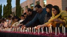 Pakistani legislators light candles during a vigil on May 14, 2015, for the victims following an attack by gunmen on a Shiite Ismaili minority bus in Karachi . (ASIF HASSAN/AFP/Getty Images)