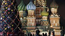 Revel in Red Square. Soak in the rich sense of history and mind-bending architecture. Look for Lenin's tomb and St. Basil's Cathedral, among other landmarks. (DENIS SINYAKOV/REUTERS)