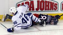 Toronto Maple Leafs defenceman Roman Polak, left, checks Columbus Blue Jackets forward Oliver Bjorkstrand in Columbus, Ohio, on March 22, 2017. (Paul Vernon/AP)