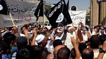 Demonstrators chant pro-ISIL slogans in front of the provincial government headquarters in Mosul on Monday, June 16, 2014. (AP)
