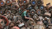 A man works at an iron scrap yard at an industrial area in the southern Indian city of Chennai on August 9, 2012. India's industrial output fell for the third time in four months in June, adding to pressure on new Finance Minister P. Chidambaram to move quickly and pull Asia's third-largest economy from its worst slowdown in almost a decade. (BABU/REUTERS)
