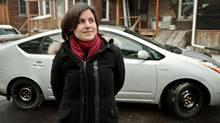 Sarah Elton in front of her 2008 Prius (Jennifer Roberts For The Globe and Mail)