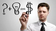 Young business man drawing a idea for making money. (Thinkstock)