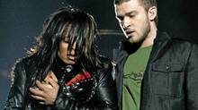 Janet Jackson reacts after fellow singer Justin Timberlake ripped off one of her chest plates at the end of their half time performance at the XXXVIII Super Bowl in Houston, Feb. 1, 2004. (WIN MCNAMEE / REUTERS)