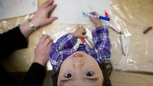 Nahomi Cedeno, 2, works with markers at Terry Tayler early learning and care centre in Vancouver on Feb. 19, 2013. (JOHN LEHMANN/THE GLOBE AND MAIL)
