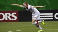 Canada's Janine Beckie celebrates after scoring against North Korea during second half FIFA U20 Women's World Cup soccer action Aug. 12 in Montreal. (Paul Chiasson/THE CANADIAN PRESS)