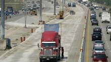 Aecon road crews work on Highway 407, north of Toronto. (Kevin Van Paassen/Kevin Van Passen/The Globe and Mail)