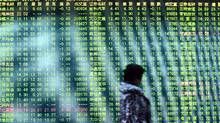 Despite this historical reluctance to embrace dividends, China has emerged as one of the best dividend trades this year, with Chinese payout stocks outperforming the market more than those in the United States and Europe. (AFP/Getty Images)
