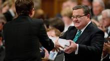 Finance Minister Jim Flaherty tables the federal budget in the House of Commons on Parliament Hill in Ottawa on Thursday, March 21, 2013. (Adrian Wyld/THE CANADIAN PRESS)