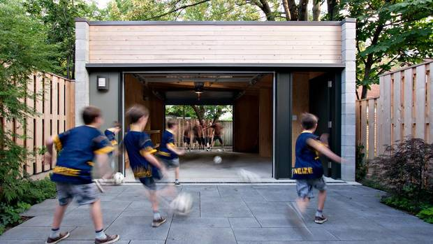 Courtyard of a Toronto home by Denegri Bessai Architects. David Wellington recruited architects Tom Bessai and Maria Denegri, who live right behind him, to replace his crumbling garage. He got a new garage, a beautiful one, but also a total remake of his south-facing yard that put a hard edge back on it. (Jesse Jackson)